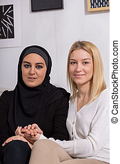 Muslim and caucasian women spending time together