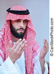 Muslim Arabic man praying