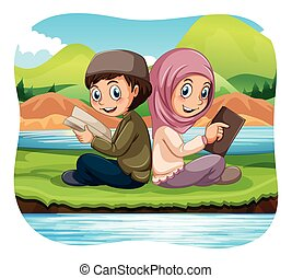 Muslim boy and girl reading in the park