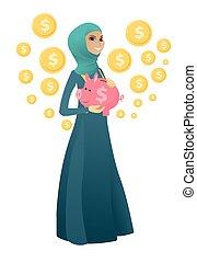 Muslim business woman holding a piggy bank.