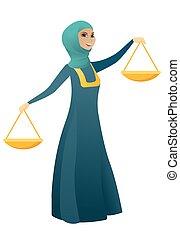 Muslim business woman holding balance scale.