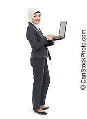 Muslim business woman with laptop