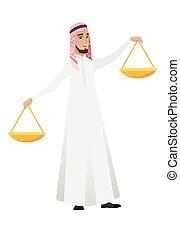 Muslim businessman holding balance scale.