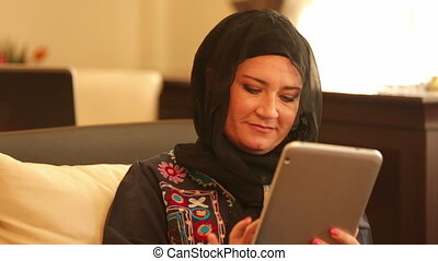 Muslim businesswoman using digital tablet