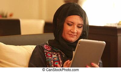 Muslim businesswoman using digital