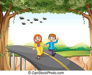 Muslim couple crossing a bridge