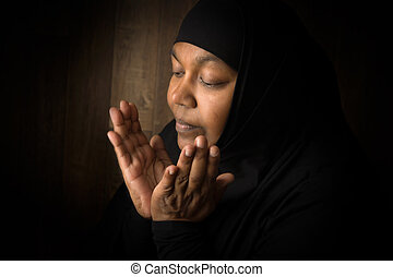 Muslim devotion - Ramadan prayer of a muslim mature woman