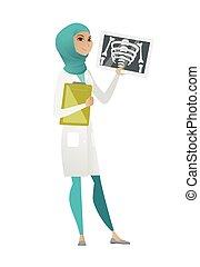 Muslim doctor examining a radiograph.