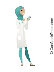 Muslim doctor holding a mobile phone.