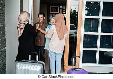 muslim family greeting at home welcoming