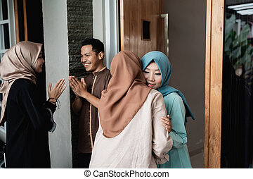 muslim family hug in eid mubarak celebration