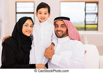 muslim family relaxing at home