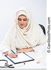 Muslim female doctor in doctor's office