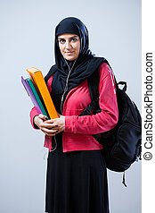 Muslim female student with backpack