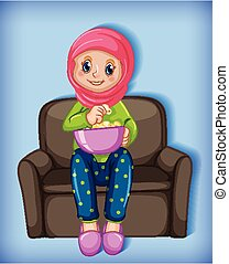 Muslim girl eating popcorn