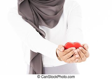 Muslim girl hold hearth