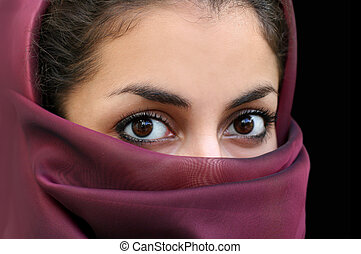 Portrait of a young arab girl in a scarf