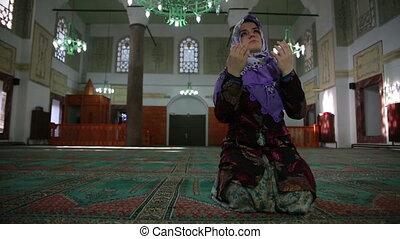 Muslim girl praying