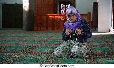 Muslim girl praying - Muslim girl saying her everyday salat...