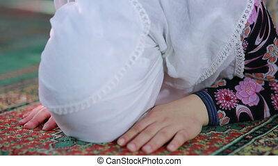Muslim girl reading Quran - Young muslim girl reading Quran...