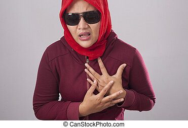 Muslim Lady in Red Having Chest Pain