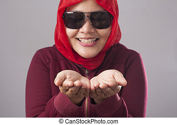 Muslim Lady in Red Shows Something in Her Empty Hands