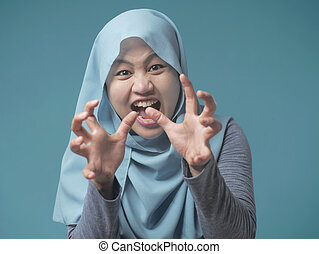 Muslim Lady in Shows Angry Gesture