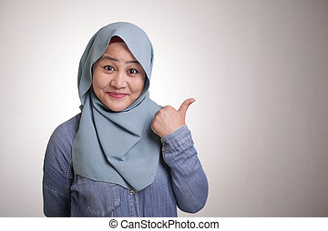Muslim Lady Presenting Something on Her Side with Copy Space