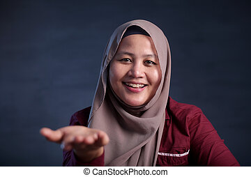 Muslim Lady Shows Something in Her Empty Hand