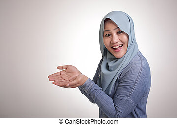 Muslim Lady Shows Something in Her Empty Hands