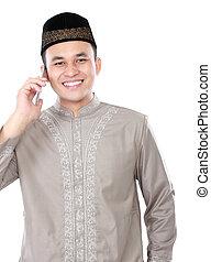 muslim man calling by mobile phone
