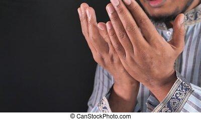 muslim man praying during ramadan .