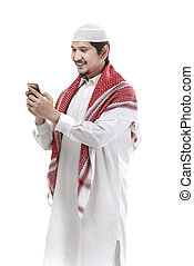 Muslim man using cellphone