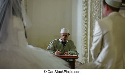 Muslim Marriage in Mosque - mullah signing marriage...
