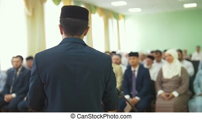 Muslim men speaker at the islamic conference, close up
