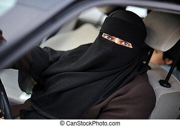 Muslim middle eastern female driver wearing veil