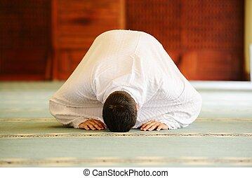 Muslim pilgrims at Miqat - Muslim wearing ihram clothes and...