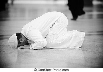 Muslim praying at Medina mosque - Islamic Holy Place