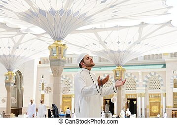 Muslim praying at Medina mosque
