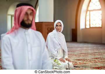 Muslim Praying man and woman in mosque