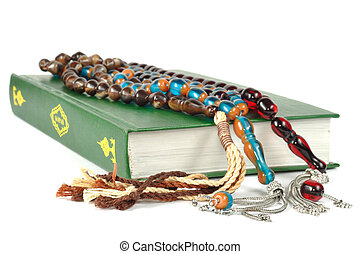 Muslim rosary beads and Quran - Muslim rosary beads on the...