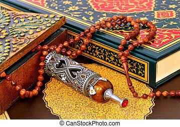 Muslim rosary on the koran - prayer and pilgrimage perfumel...