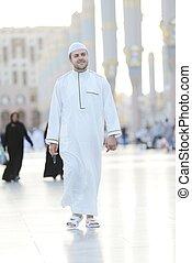 Muslim walking - Islamic Holy Place
