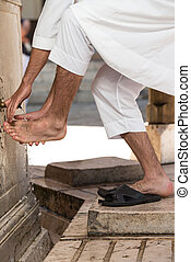 Muslim Washing Feet Before Entering Mosque - Muslim Man...