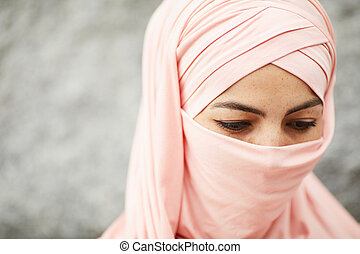 Muslim woman deep in thoughts