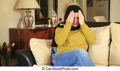 Muslim woman having headache - Muslim woman suffering a...
