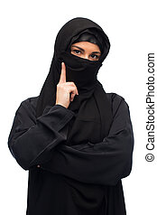 muslim woman in hijab over white background