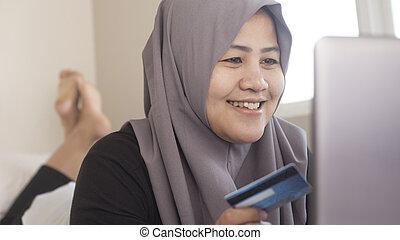 Muslim Woman Making Online Purchase