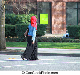 Muslim Woman - Muslim woman crossing an intersection.