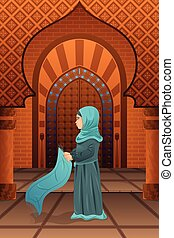 Muslim woman praying in the mosque
